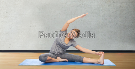 happy woman making yoga and stretching