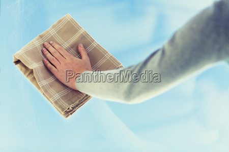 close up of woman hand cleaning
