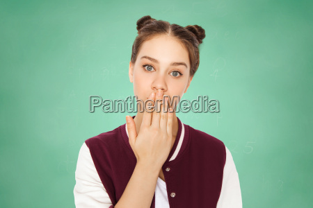 confused teenage student girl covering her