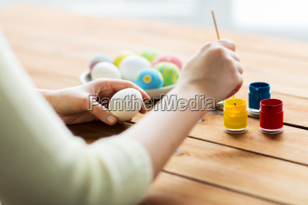 close up of woman coloring easter