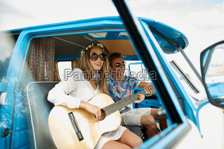 smiling hippie couple with guitar in