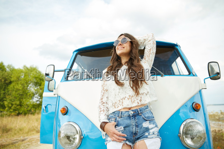 smiling young hippie woman in minivan