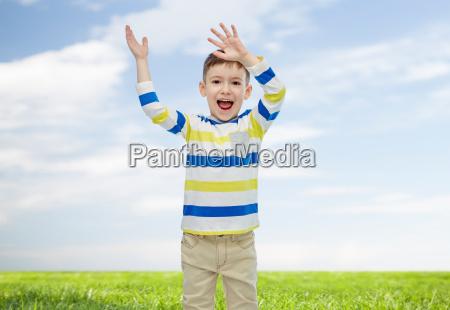 happy little boy waving hands