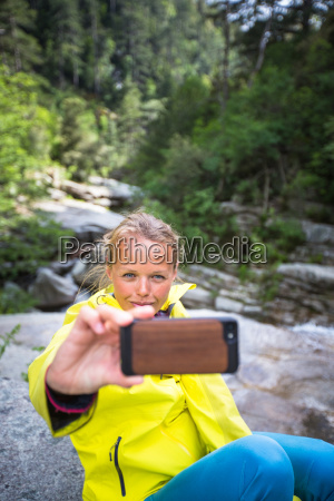 pretty young female hiker taking a
