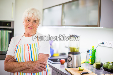 senior womangrandmother cooking in a modern