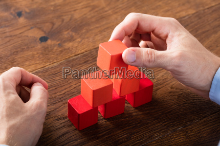 person building blocks