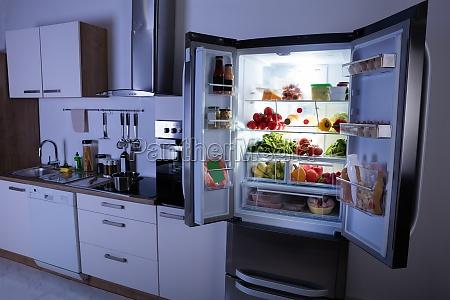 open refrigerator in modern kitchen