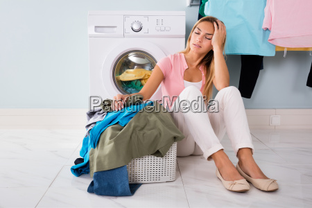 unhappy woman looking at clothes in