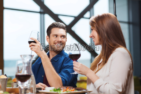 couple dining and drinking wine at
