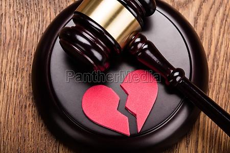 red broken heart on wooden gavel