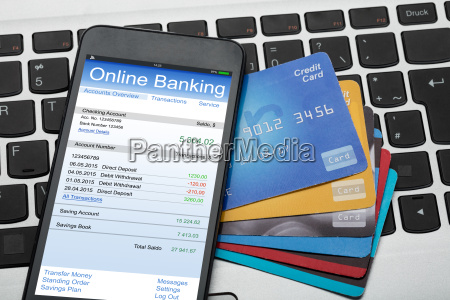 mobilephone and credit cards on laptop