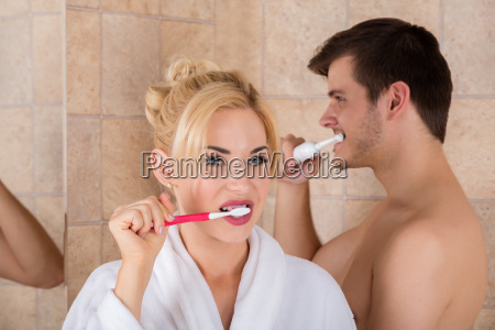 portrait of man and woman brushing