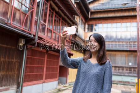 young woman taking photo by mobile