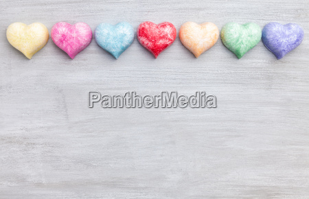 love concept colorful hearts on grey