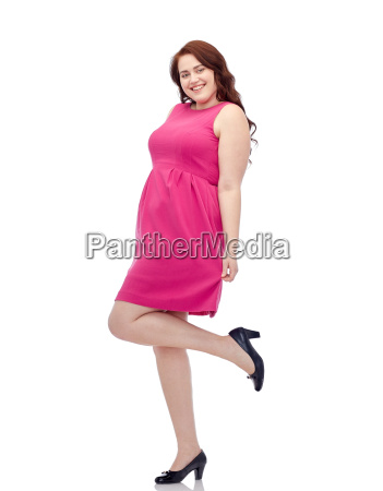 happy young plus size woman posing