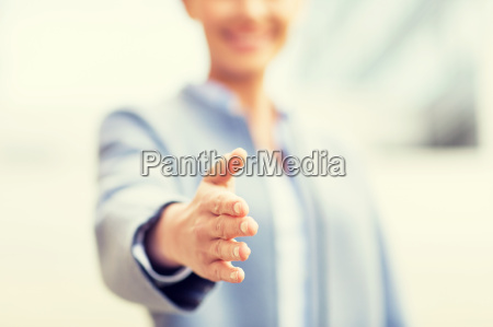 close up of woman giving hand