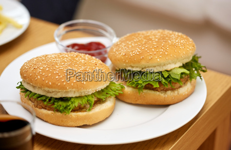 close up of two hamburgers on