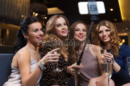 women with smartphone taking selfie at
