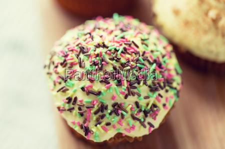 close up of glazed cupcake or