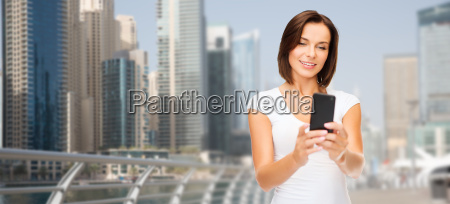 woman taking selfie by smartphone over