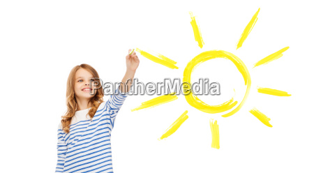 girl drawing big sun in the