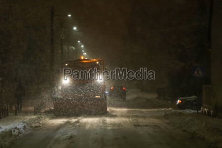 snowplow cleaning streets