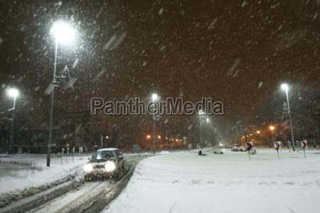 snowy traffic at night