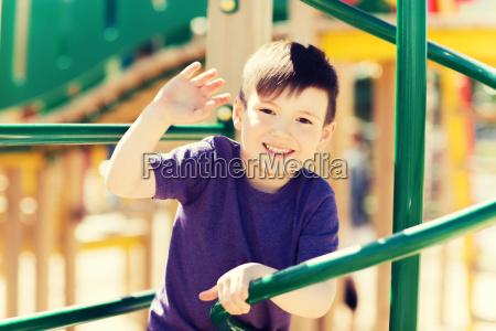 happy little boy climbing on children