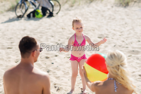 happy family playing with inflatable ball