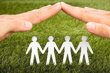 person hand schutz papercut