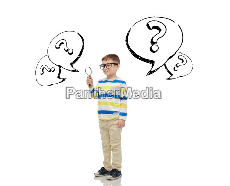 little boy in eyeglasses with magnifying