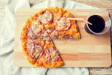 close up of pizza with coca