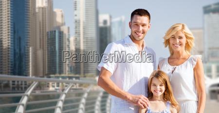 happy family over dubai city street