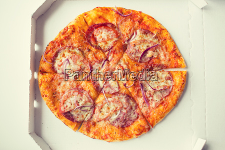 close up of pizza in paper