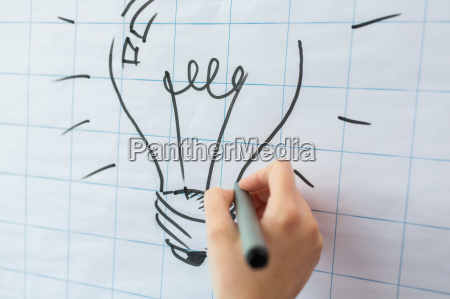 close up of hand drawing light