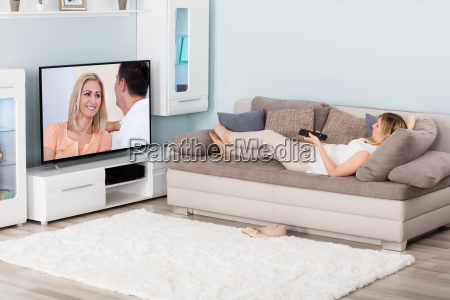 woman watching movie on television at