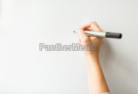 close up of hand writing something