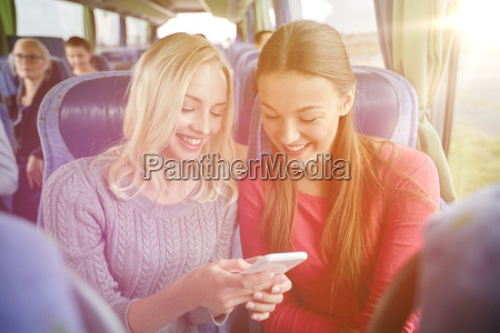 happy young women in travel bus