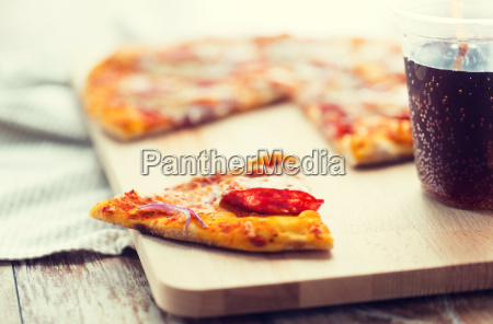 close up of pizza with carbonated