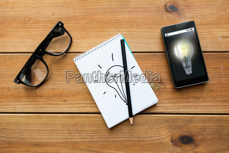 close up of notepad smartphone and