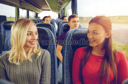 happy young women talking in travel