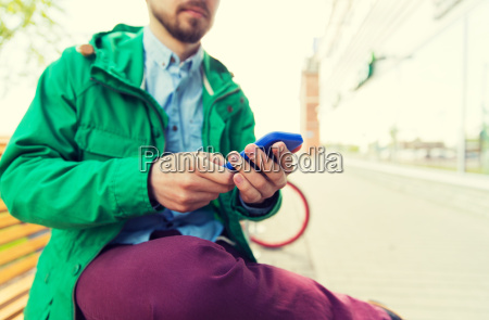 close up of man with smartphone