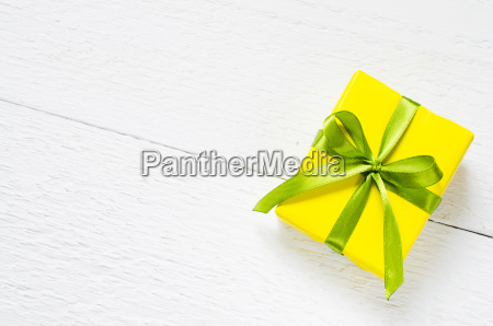 present on wooden background mothers day