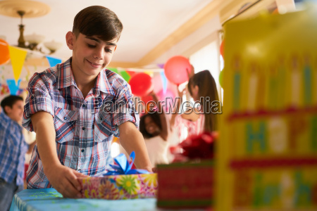 child putting present on table during