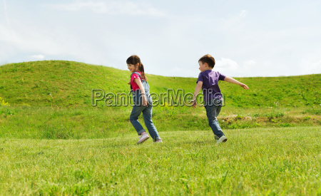 happy little boy and girl running