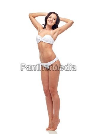 happy young woman in white bikini