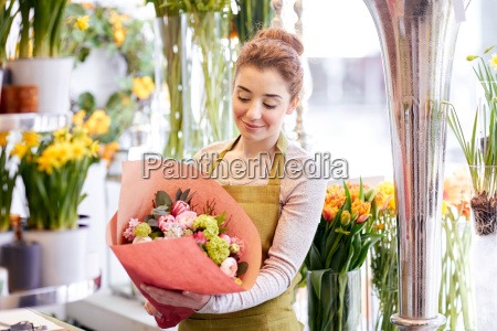 smiling florist woman with bunch at