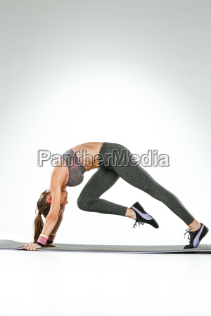 beautiful slim brunette doing some stretching