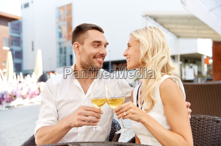 happy couple drinking wine at open