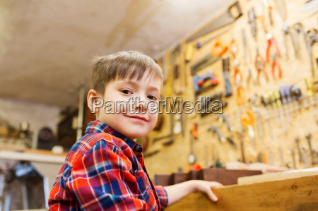 happy little boy with wood plank